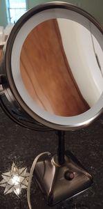 Bronze lighted makeup vanity mirror
